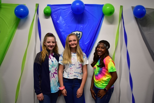 Students dressed up in tie dye apparel.