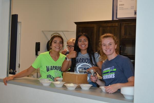 Students serving ice cream.
